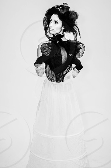 woman in couture black and white sheer puff dress photo