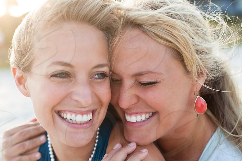 Sisters companionship happiness bonding beach photo