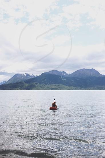 man kayaking on water photo