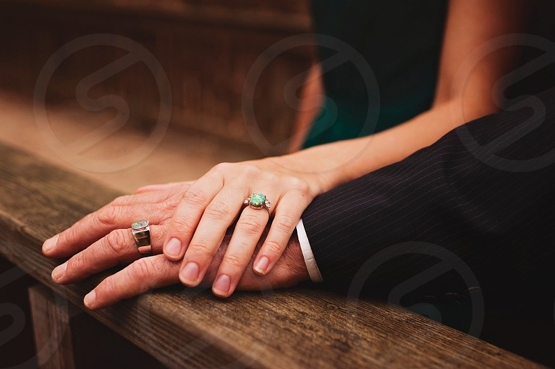 man and woman's hands with rings photo
