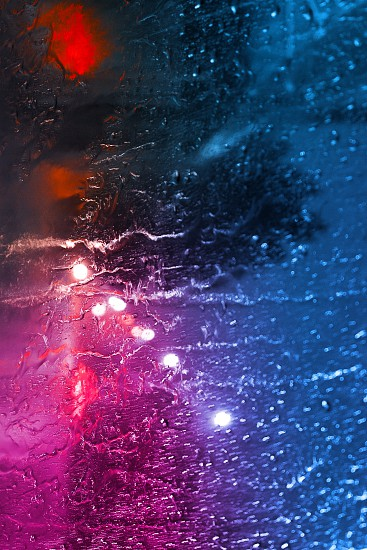 Creative fluorescent color layout made of raindrops on the glass. Flat lay. Nature concept. Soft focus photo