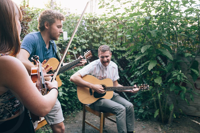 3 musicians performing at the garden photo