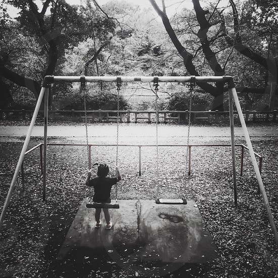 black and white photo of swing set photo