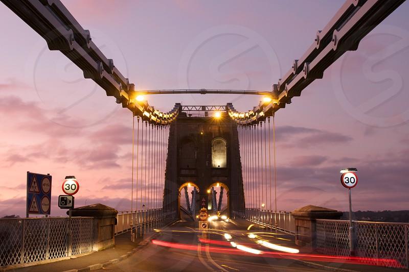 Sunset at the Menai Suspension Bridge North Wales UK. photo