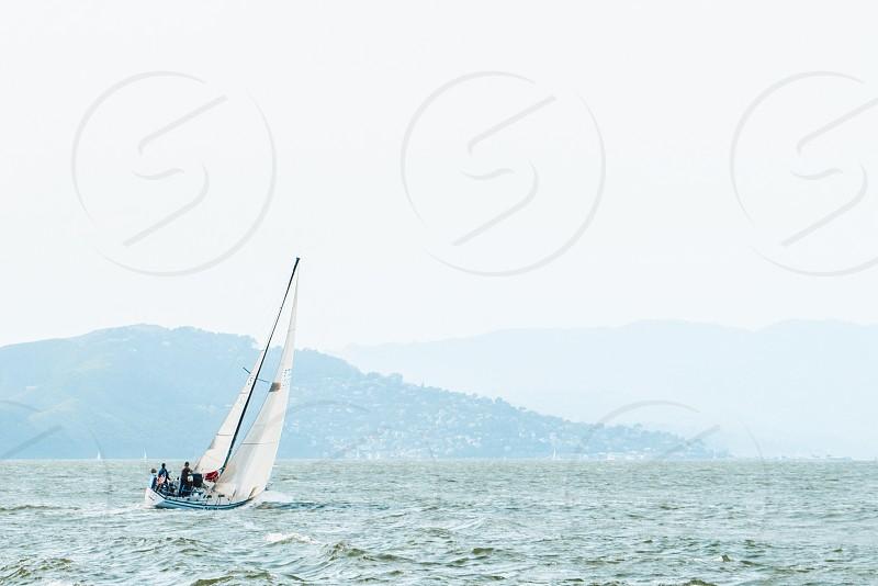Tall ships and sailboats saling in the San Fransisco Bay photo