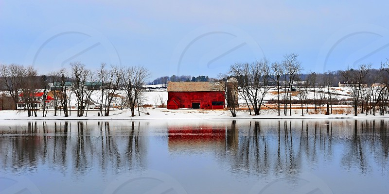 Red Barn Reflecting in river. photo