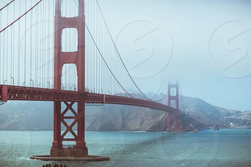 Golden Gate Bridge San Francisco California fog bay ocean water pacific photo