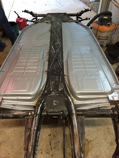 Floor pans installed on 1968 beetle. Almost ready to reattach the body! photo