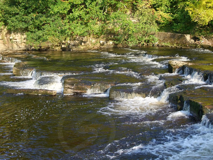 UK. ENGLAND. Barnard Castle. County Durham. The falls on the River Tees below the castle photo