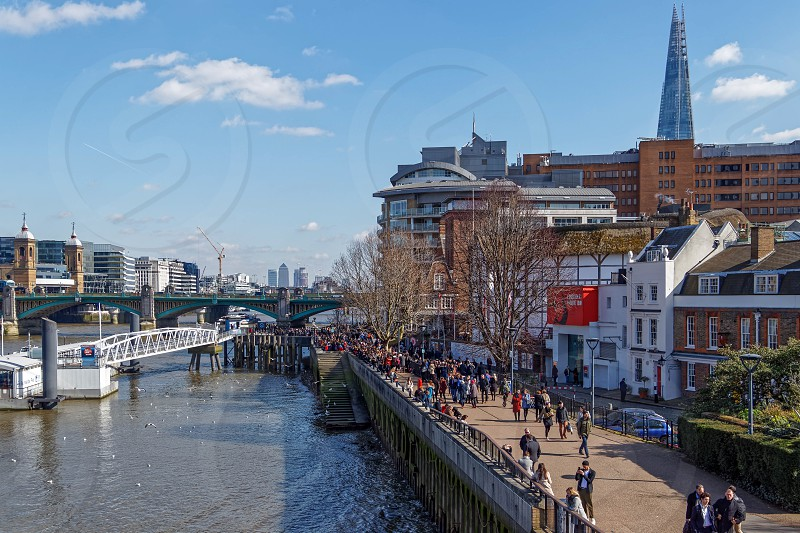 LONDON/UK - MARCH 21 : View along the South Bank of the River Thames to the City of London on March 21 2018. Unidentified People. photo