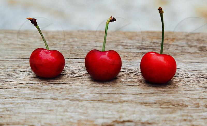 Three Cherries on Wood photo
