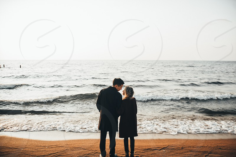 Happy lovers on beach photo