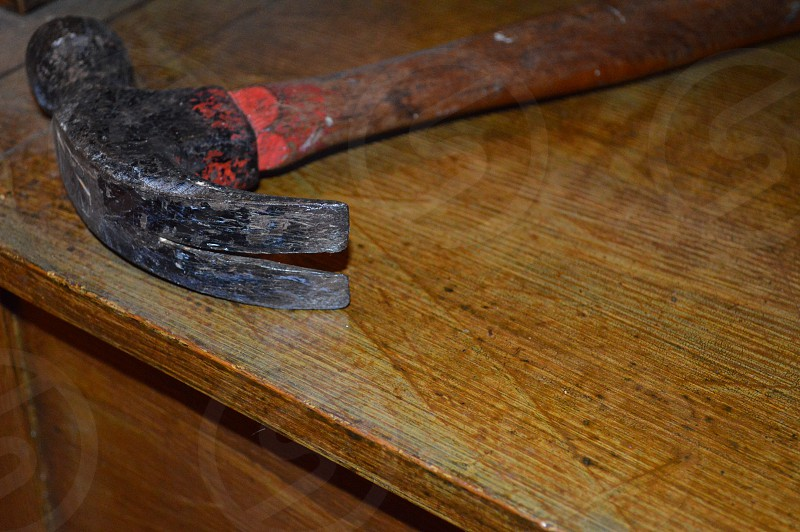 brown wooden handled hammer photo