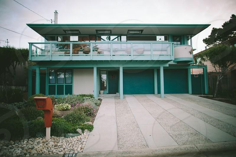 green 2 storey house photo