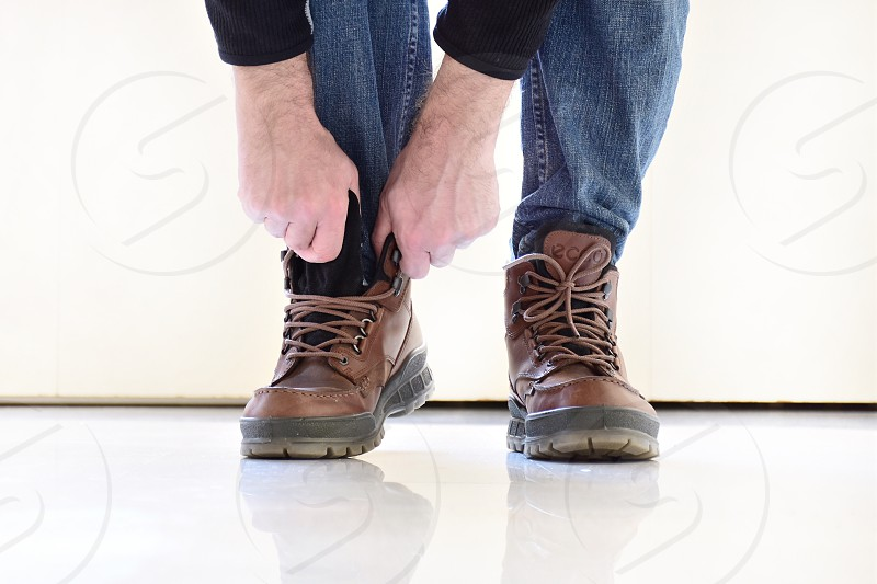 person wearing brown leather shoes photo