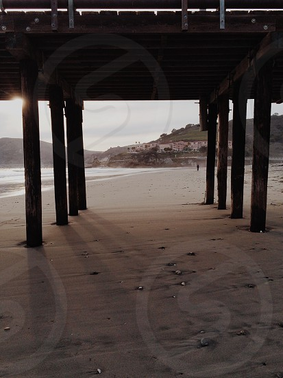 brown wooden structure near the seashore photo
