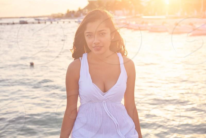 Mexican latin woman at Caribbean sea of Riviera Maya in Mexico photo