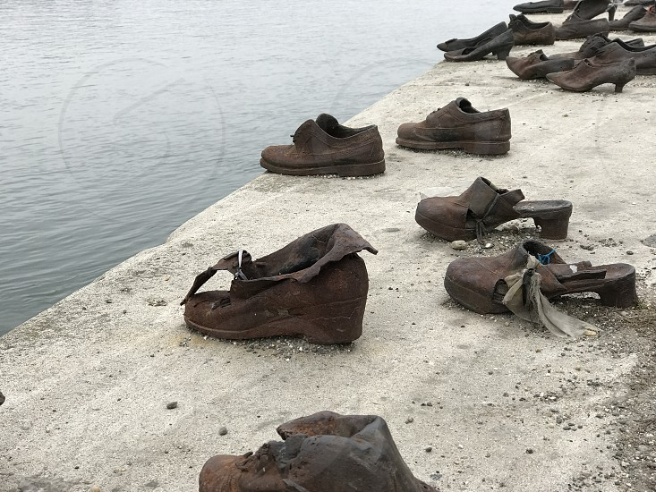 Shoes on the Danube river bank photo