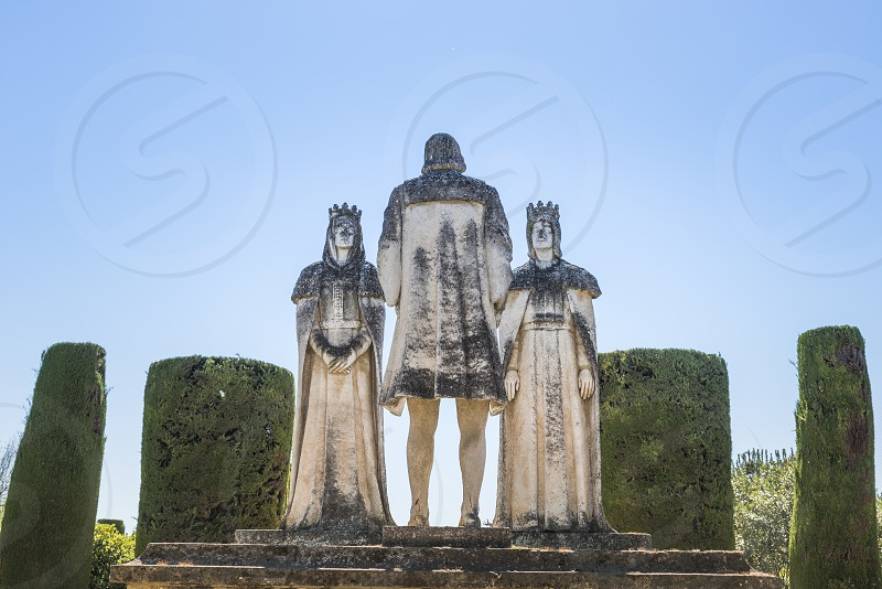Old Stone Statues of the Christian Kings with Cristobal Colon in the gardens of the Alcazar in Cordoba Spain photo
