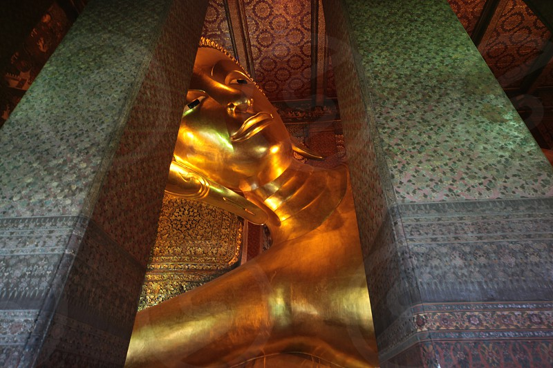 the reclining buddha at wat Pho in Banglamphu in the city of Bangkok in Thailand in Suedostasien. photo