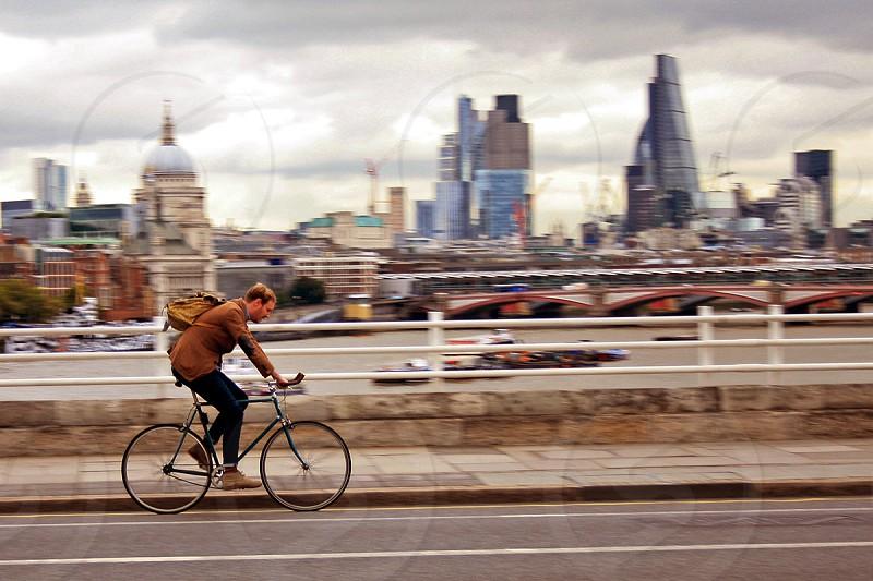 London; sky line; waterloo bridge; workshops;  Cycling home london Skyline St Paul's Commuter Cycle London City Sky Scrapper travel work cloudy london weather  photo