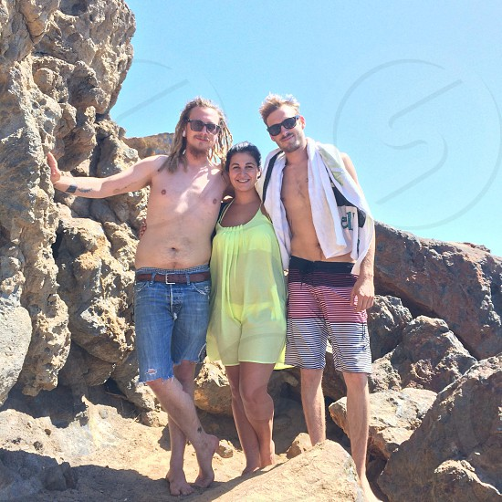 woman in yellow dress between two men standing and smiling photo