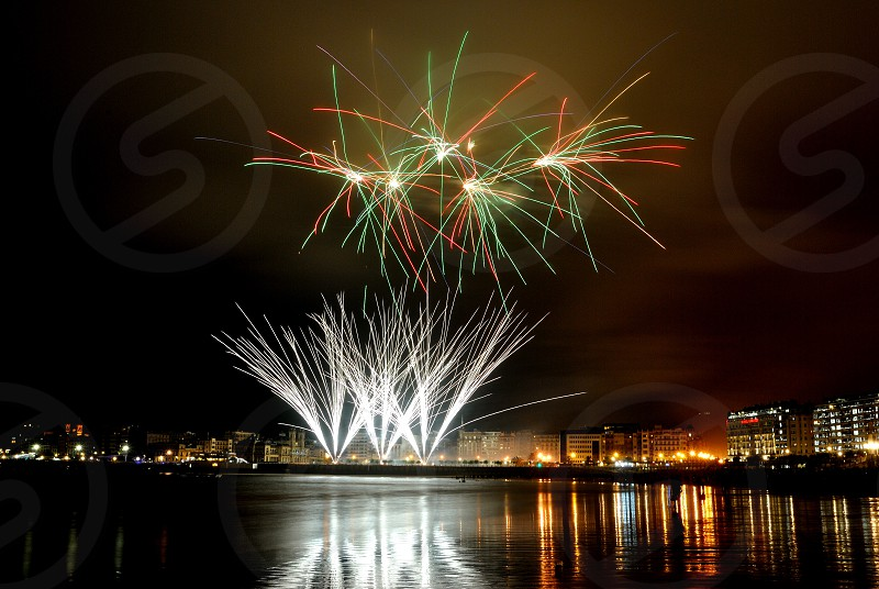 white green and yellow fireworks display during night time photo