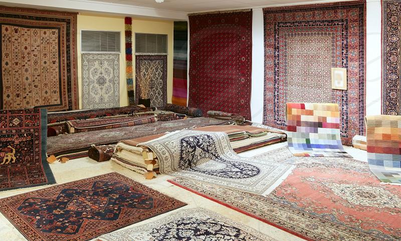 Arabic carpet shop exhibition colorful carpets exposition room photo