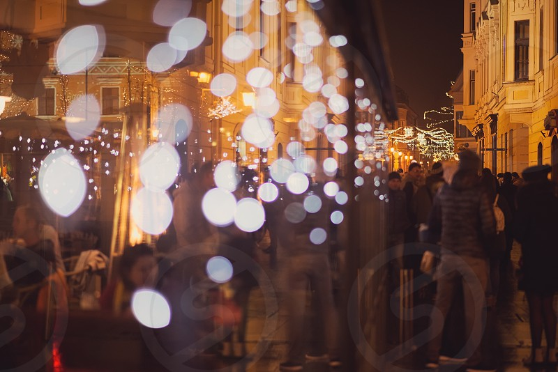 Blurred Street Lights and Crowd at Night photo