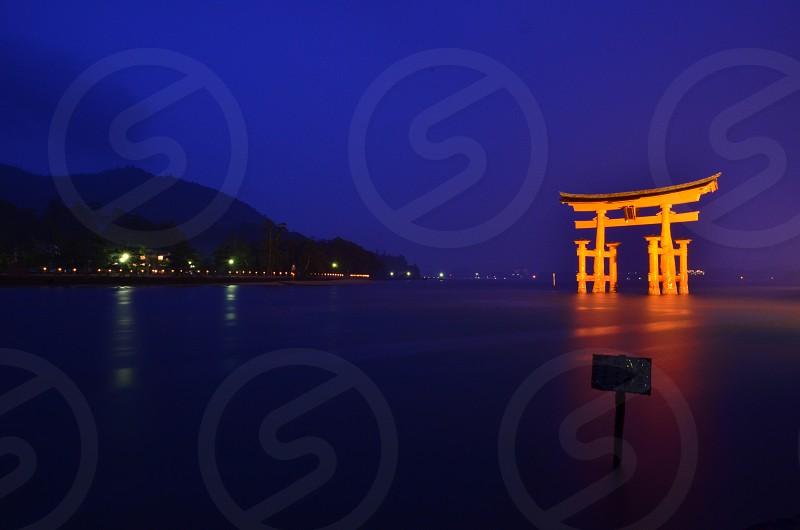 Otori at Itshukishima Shrine on Miyajima Island Japan by night. Long exposure.  photo