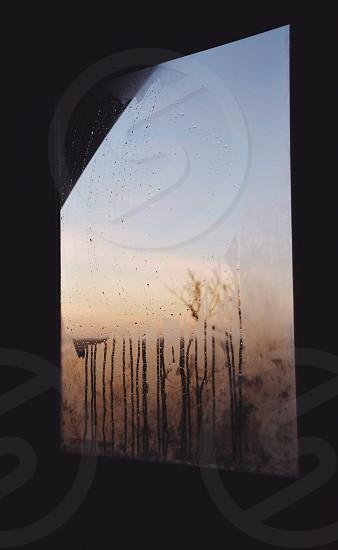 Window cold sunrise tarnished blur misty steamy photo