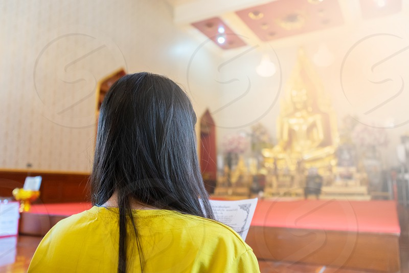 Girl praying at temple. copy space. photo