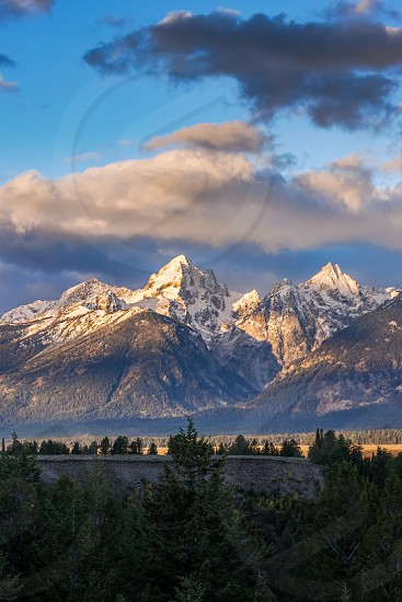 Sunrise over the Grand Tetons in Wyoming photo