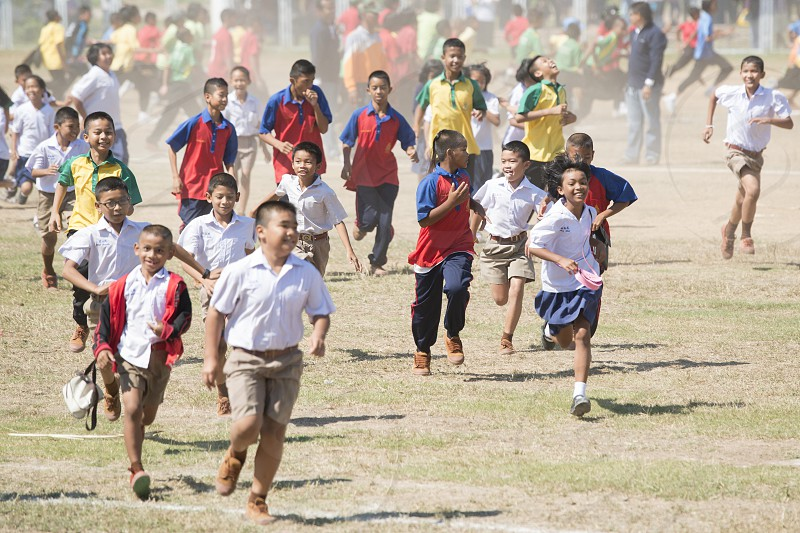 school childern  at the Elephant Round-up Festival in the city of Surin in Northeastern Thailand in Southeastasia.  photo