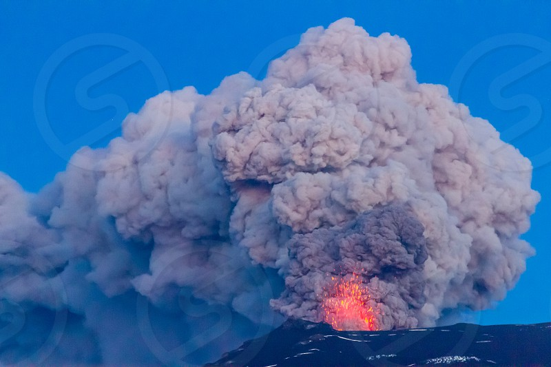 Eruption of the famous Icelandic volcano Eyjafjallajokull. Its ashes paralysed the European airspace in 2010 causing misery for lots of passengers around the world. I saw it live.    PS : no need for a model release. photo