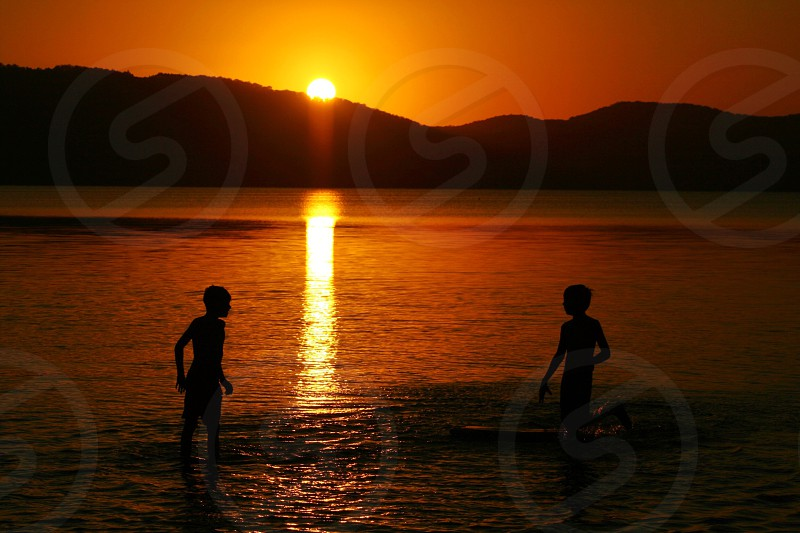 Playing in the lake at Sunset photo