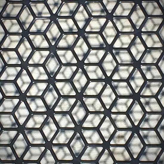 Patio mesh metal cube hexagon optical illusion. photo