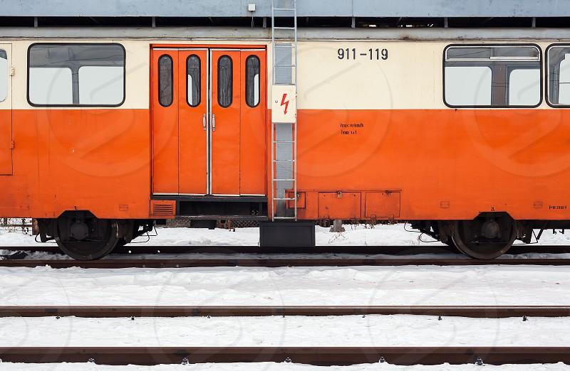 Old used orange wagon exterior winter day. photo