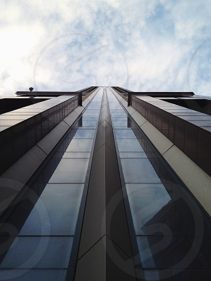 grey glass high rise building photo