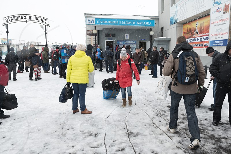 PETROPAVLOVSK KAMCHATKA RUSSIA - MARCH 19 2015: Passengers in the baggage claim area and zone exit of passengers from platform. Terminal airport Petropavlovsk-Kamchatsky City (Yelizovo airport). photo