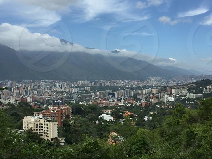 City Caracas Venezuela mountain clouds South America buildings apartments  photo