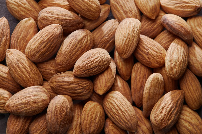 Lots of loose almonds without their shells. Natural and organic. photo