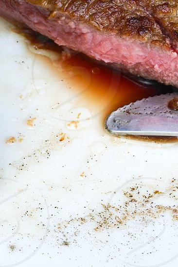 fresh juicy beef ribeye steak grilled sliced on a plate photo