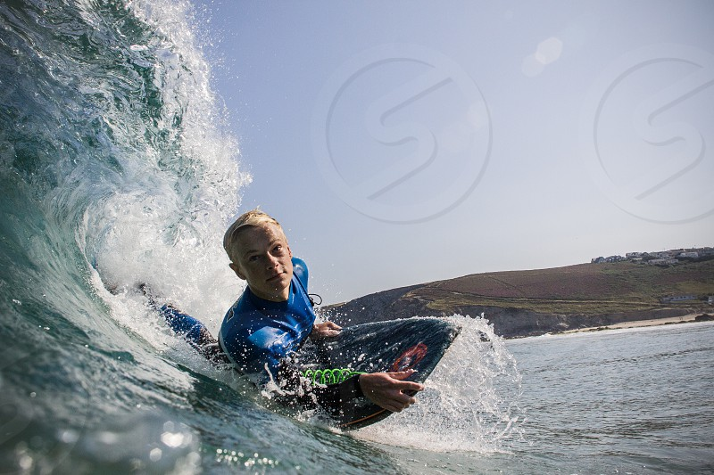 Boadyboarder pulling into a barrel. Surfing at Porthtowan beach in Cornwall UK. Taken from the water. photo