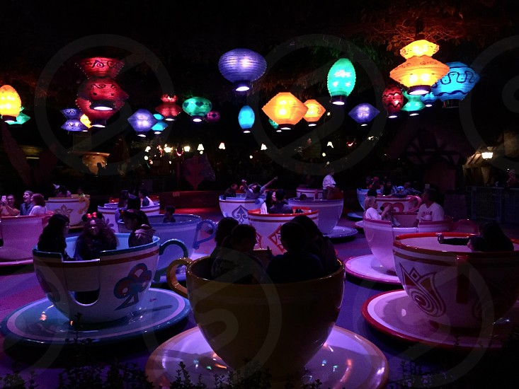 Cup n soccer ride in Disney .. People looks more beautiful in dark lights..  photo