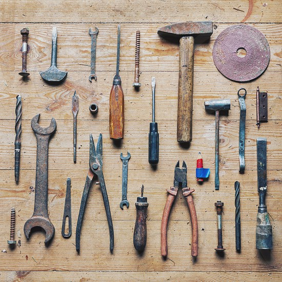 Old vintage tools on wooden background photo