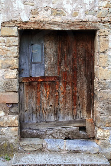 aged wood doors weathered vintage architecture detail photo