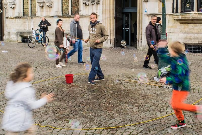 Children chasing bubbles photo