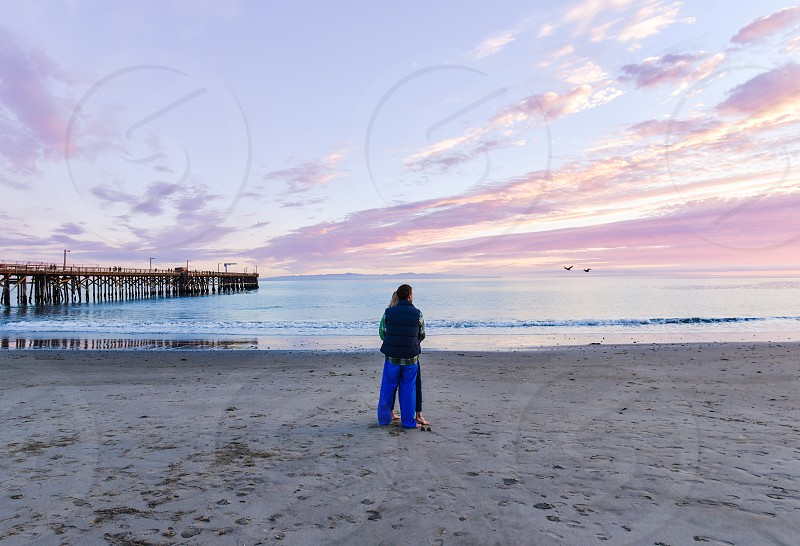 couple sunset beach pier sand photo