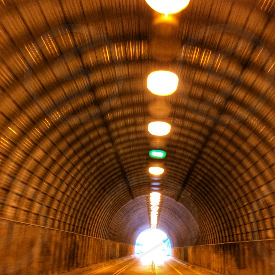 low angle photo of brown concrete tunnel photo